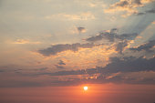 Backgrounds of colorful and beautiful sunset / sunrise with clouds with sunlight on dramatic sky texture