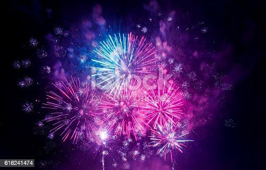 istock beautiful colorful firework at night 616241474