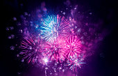 Purple colorful fireworks and bokeh in New Year eve and copy space. Abstract background holiday.