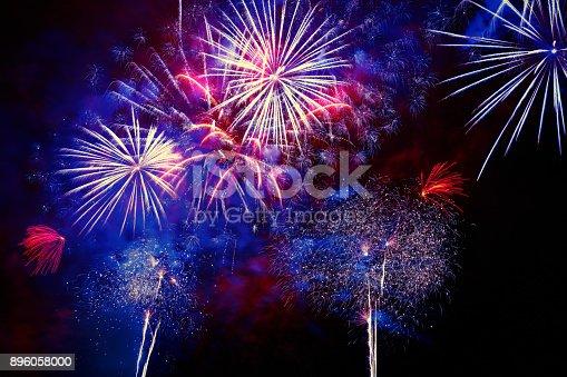 istock Beautiful colorful firework at night 896058000