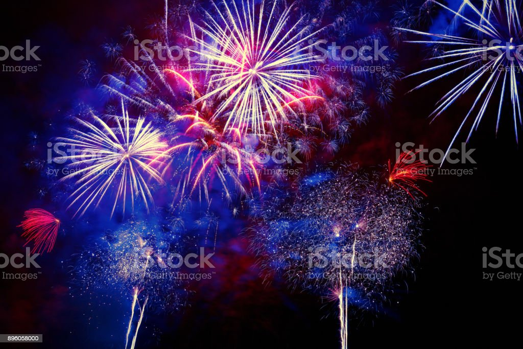 Beautiful colorful firework at night stock photo