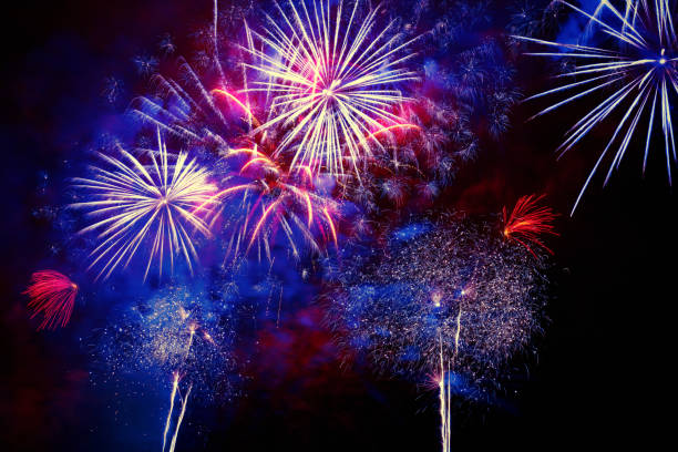 beautiful colorful firework at night - independence day stock photos and pictures