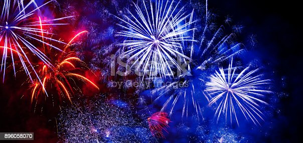 istock Beautiful colorful firework at night 896058070