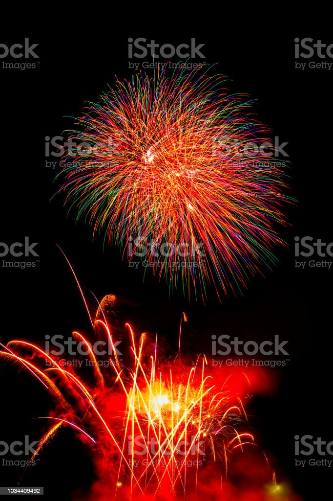 beautiful colorful firework isolated display for celebration happy new year and merry christmas on black isolated background stock photo