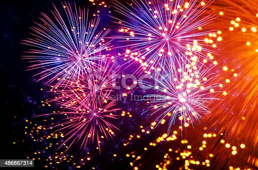 istock beautiful colorful firework with abstract lights 486867314