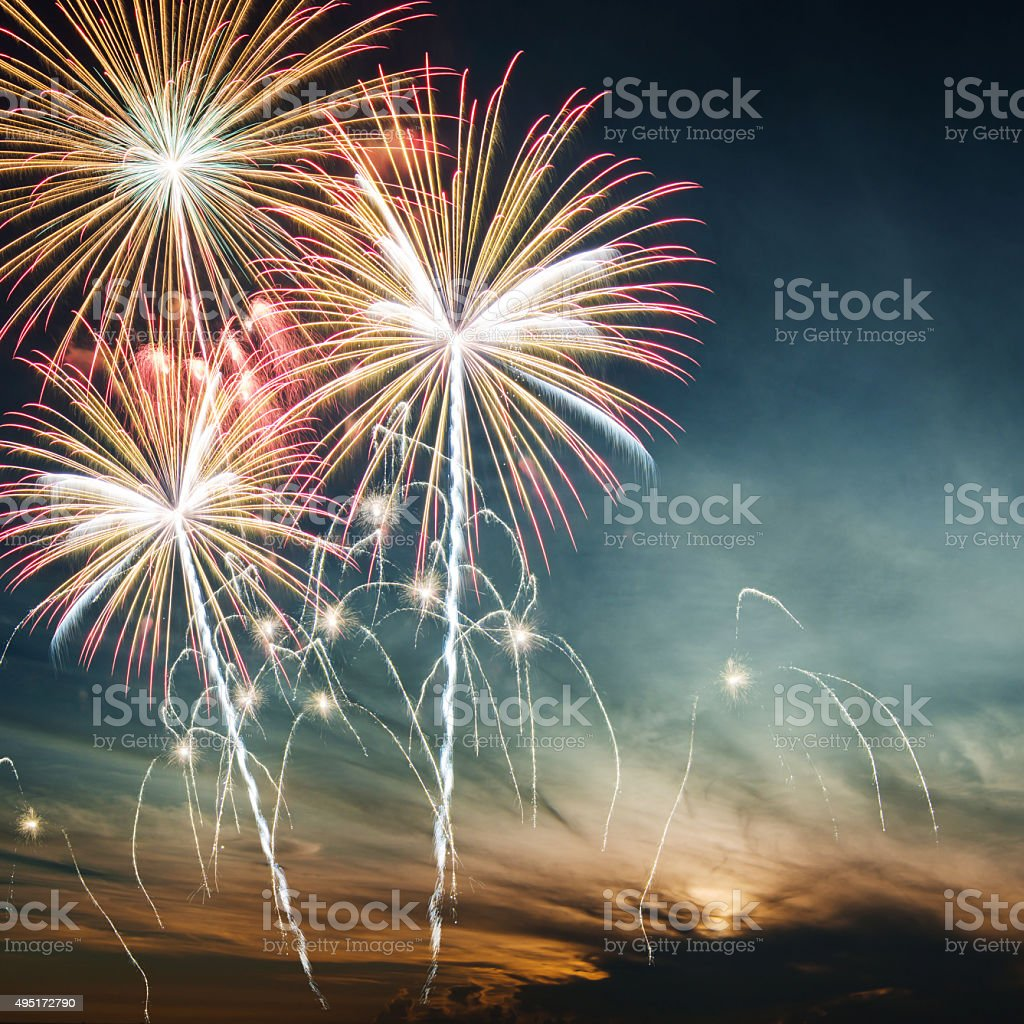 Beautiful colorful holiday fireworks in the evening sky stock photo