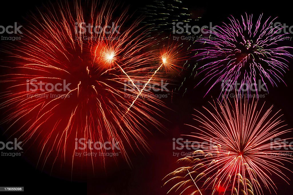 Beautiful colorful holiday fireworks on the black sky royalty-free stock photo