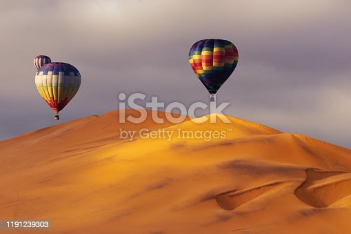 530709531 istock photo Beautiful Colorful Hot Air Baloons and dramatic clouds over the sand dunes in the Namib desert 1191239303
