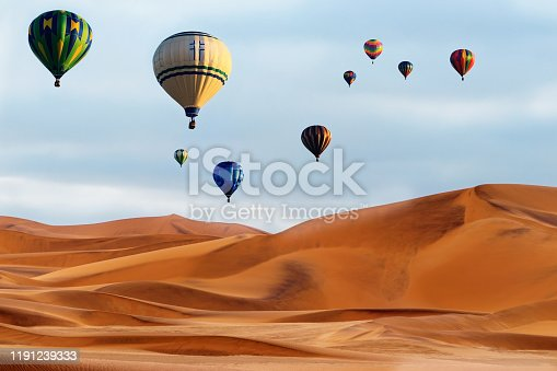 530709531 istock photo Beautiful Colorful Hot Air Baloons and dramatic clouds over the sand dunes in the Namib desert 1191239333