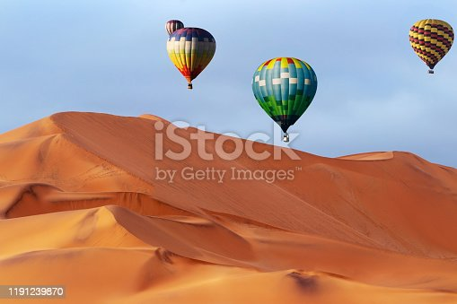 530709531 istock photo Beautiful Colorful Hot Air Baloons and dramatic clouds over the sand dunes in the Namib desert 1191239870