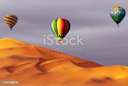 530709531 istock photo Beautiful Colorful Hot Air Baloons and dramatic clouds over the sand dunes in the Namib desert 1191239916
