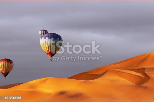530709531 istock photo Beautiful Colorful Hot Air Baloons and dramatic clouds over the sand dunes in the Namib desert 1191239953