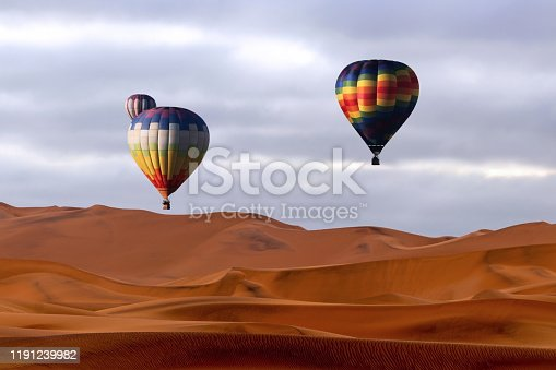 530709531 istock photo Beautiful Colorful Hot Air Baloons and dramatic clouds over the sand dunes in the Namib desert 1191239982