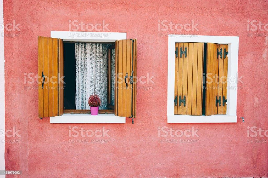 Beautiful colorful house facade on Burano island stock photo