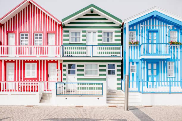 beautiful colorful houses at the costa nova beach in portugal - aveiro imagens e fotografias de stock