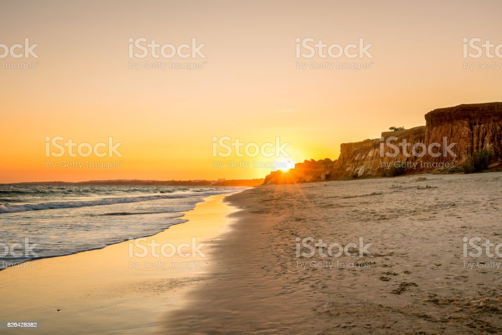 Beautiful colorful sunset in Algarve Portugal. stock photo