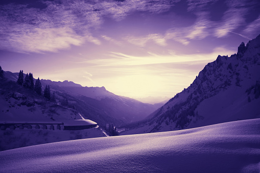 Beautiful colorful sunset, St. Anton am Arlberg ski area, Austria. ST. Anton am Arlberg ski area (ST. Anton, Lech, Zurs, Stuben, St. Christoph), located in Tyrol, Austria on Alps. Highest peak is Valluga 2810m. Ski resort is famous for