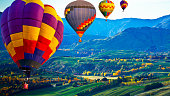 istock Beautiful colors of the hot air balloons flying over on the hill at new zealand 1246844653