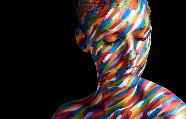 Beautiful colours Cropped shot of a young woman posing with paint on her face body paint stock pictures, royalty-free photos & images