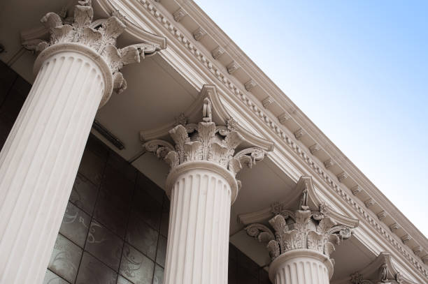 Beautiful columns of the capital on the facade of the historic building stock photo