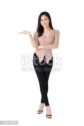 istock Beautiful confident Asian woman standing with open palm gesture 1008108430