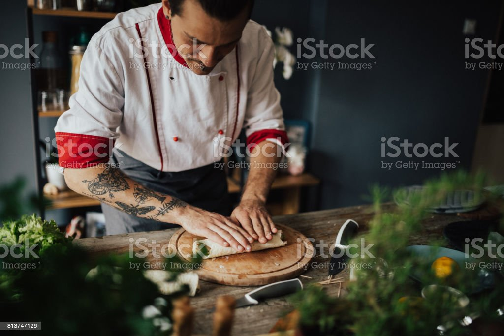 Beautiful cook is making a wrap sandwich stock photo