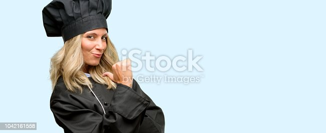 istock Beautiful cook woman chef proud, excited and arrogant, pointing with victory face 1042161558