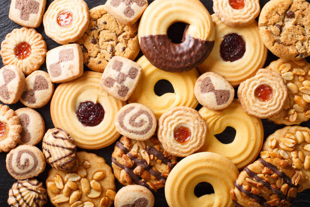 Beautiful cookies assorted close-up. background horizontal top view Beautiful cookies assorted close-up. background horizontal view from above biscuit stock pictures, royalty-free photos & images