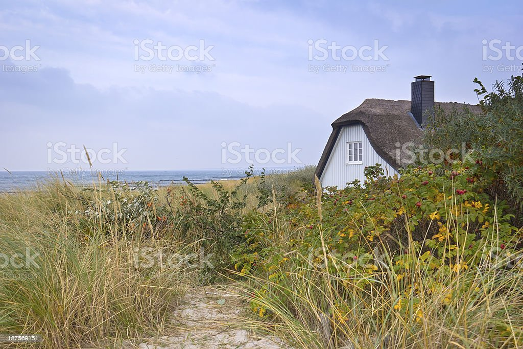 Beautiful cottage house on the shore of Ahrenshoop, Germany stock photo