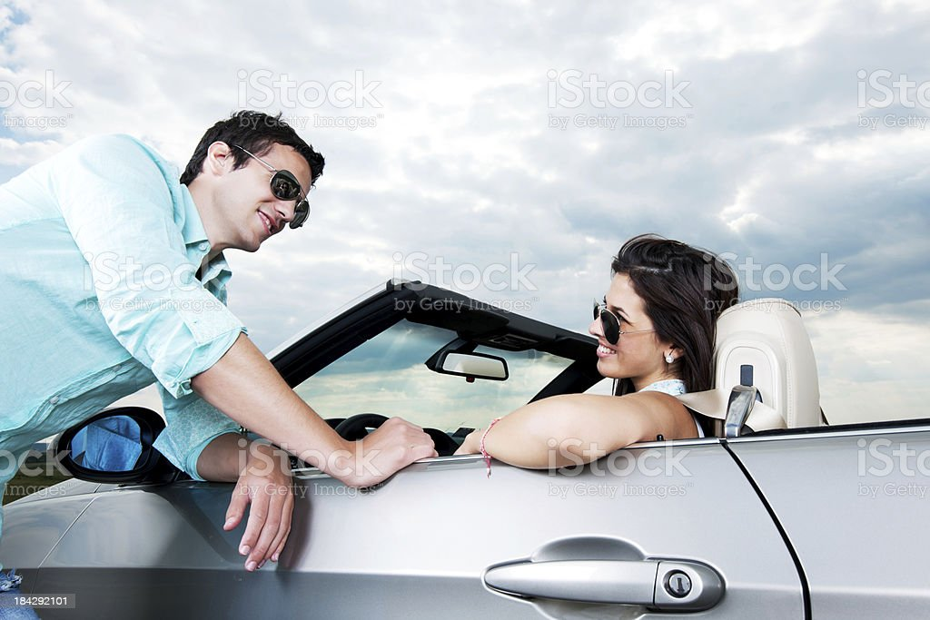 Beautiful couple and a Convertible car. royalty-free stock photo