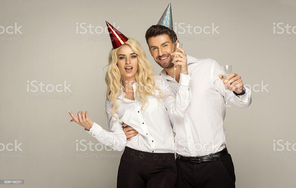 Beautiful couple celebrating new year's eve stock photo