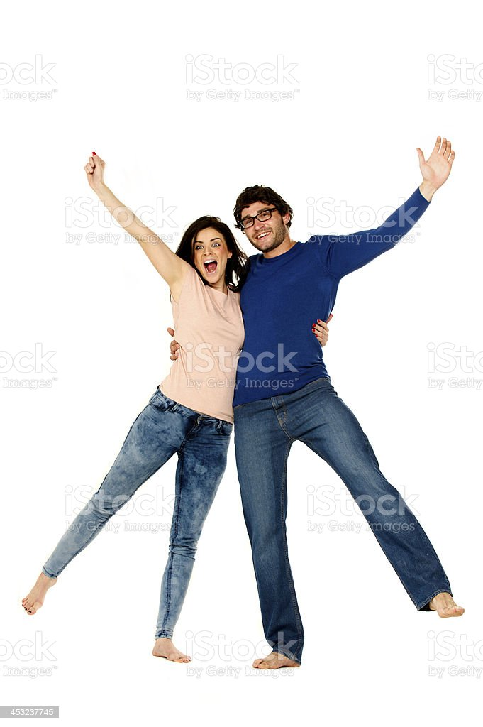 Beautiful couple cheering and celebrating isolated on a white background stock photo