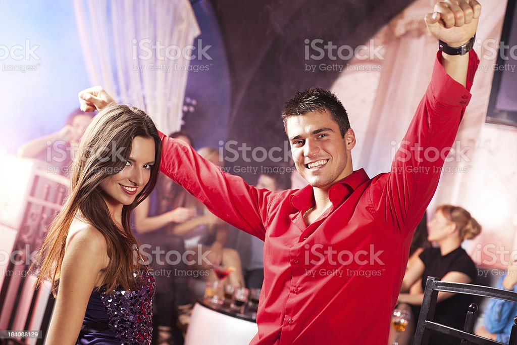 Beautiful couple dancing at the disco. royalty-free stock photo