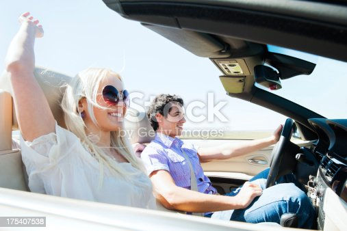 481388538 istock photo Beautiful couple driving in their Convertible car. 175407538