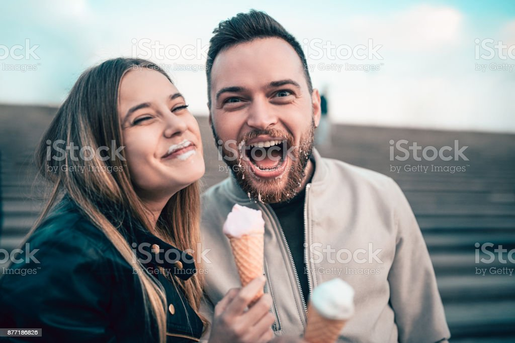 Beautiful Couple Eating Ice Cream in Autumn stock photo