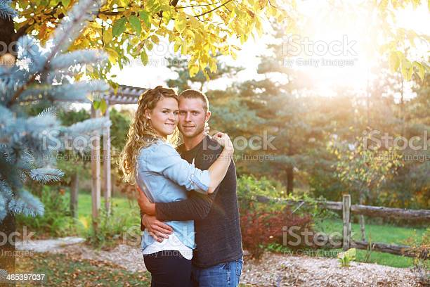 Photo of Beautiful Couple Embracing in a Garden