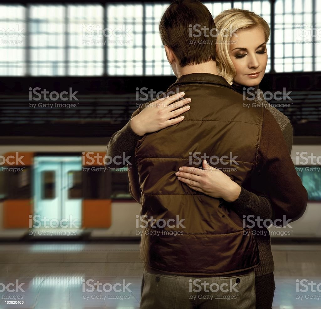 Beautiful couple embracing on train station royalty-free stock photo