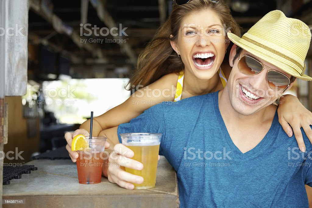 Beautiful couple enjoying a cocktail royalty-free stock photo