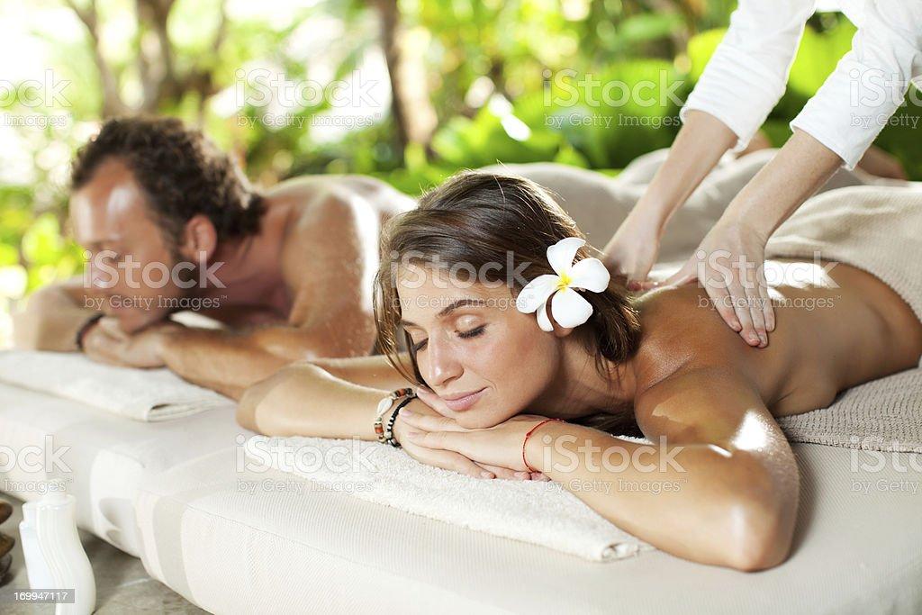 Beautiful couple enjoying in a back massage. royalty-free stock photo