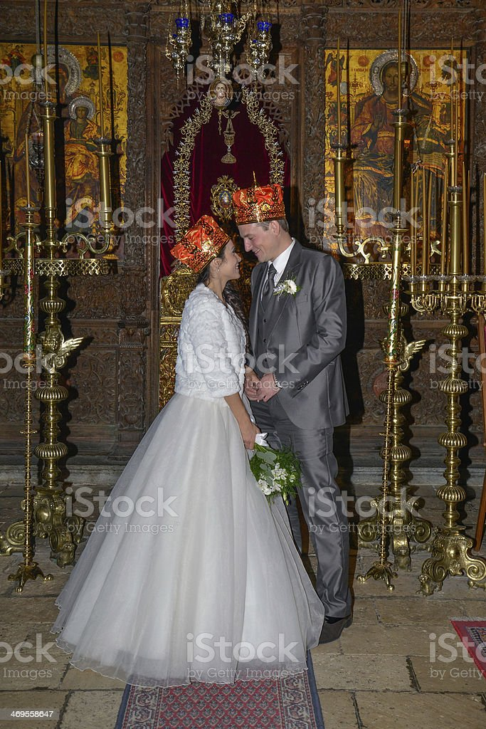 Beautiful couple getting married in an orthodox church royalty-free stock photo
