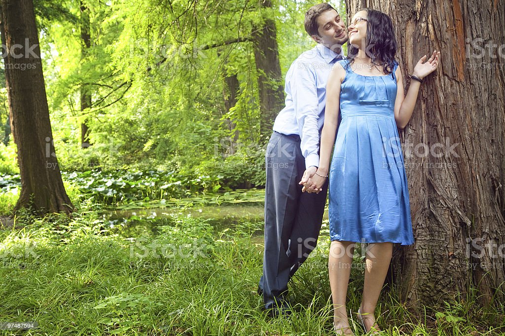 Beautiful couple having a romantic moment in the forest royalty-free stock photo