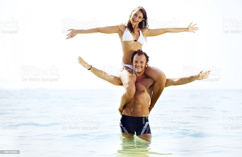 Beautiful couple having fun in water on a summer holiday. royalty-free stock photo