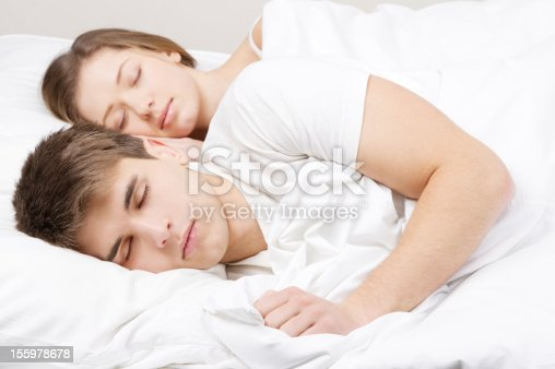 528422658 istock photo Beautiful couple in bed 155978678