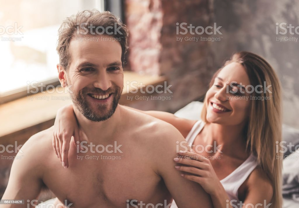 Beautiful couple in bed foto stock royalty-free