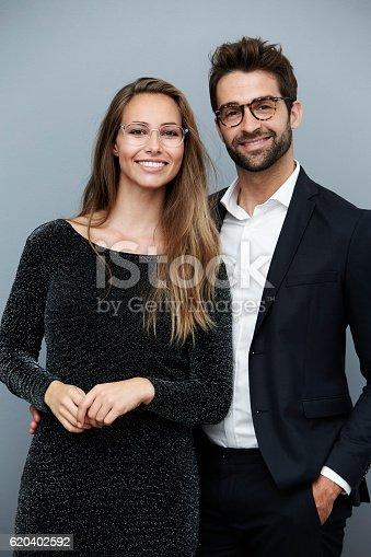 620404536istockphoto Beautiful couple in glasses, portrait 620402592