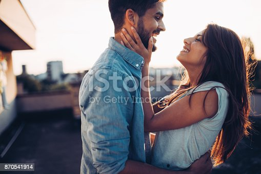 istock Beautiful couple in love dating outdoors and smiling 870541914
