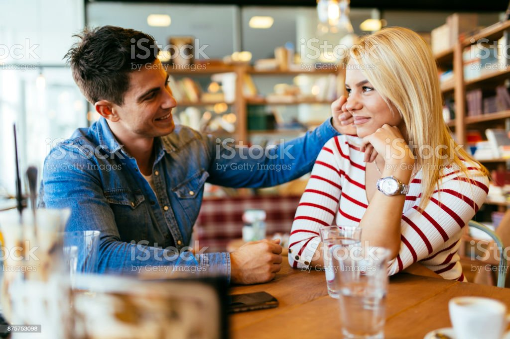 Beautiful couple in love flirting in cafe stock photo