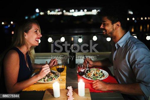 istock Beautiful couple in love having romantic dinner at night 686275344
