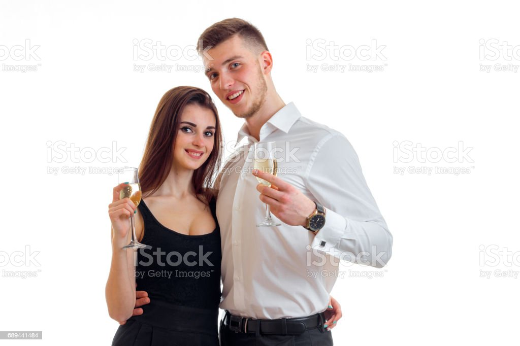 beautiful couple in love smiling and holding wine glasses close-up stock photo