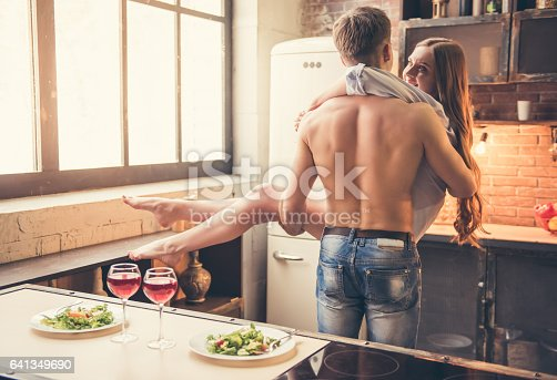 istock Beautiful couple in the kitchen 641349690